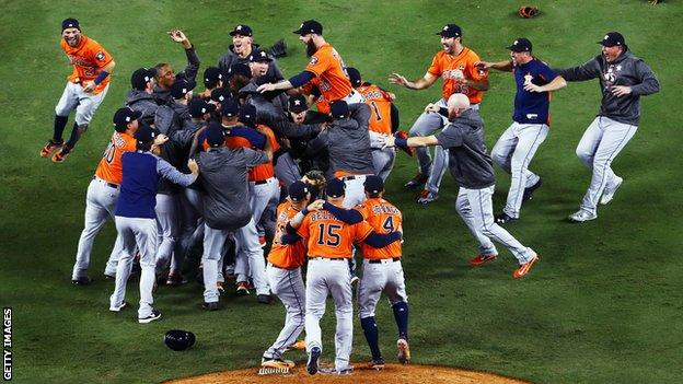 The Houston Astros celebrate after winning the 2017 World Series