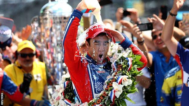 Takuma Sato celebrates