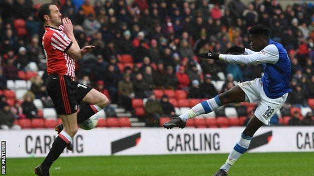 Lucas Joao strikes Sheffield Wednesday's opening goal past defender John O'Shea's attempted block