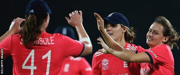 England celebrate a wicket by Laura Marsh (far right)