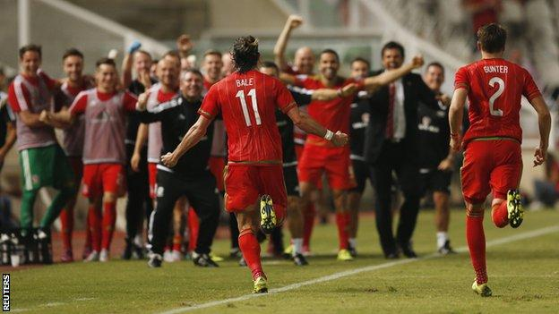 Wales forward Gareth Bale celebrates after scoring the winning goal against Cyprus