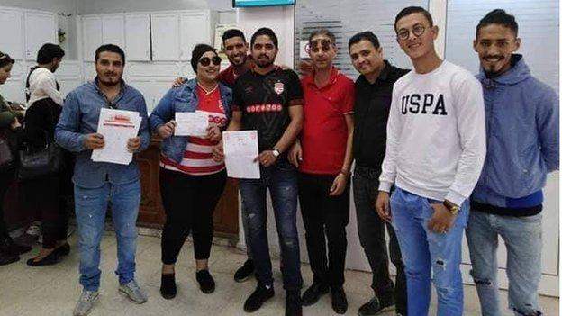A group of fans after donating to Club Africain