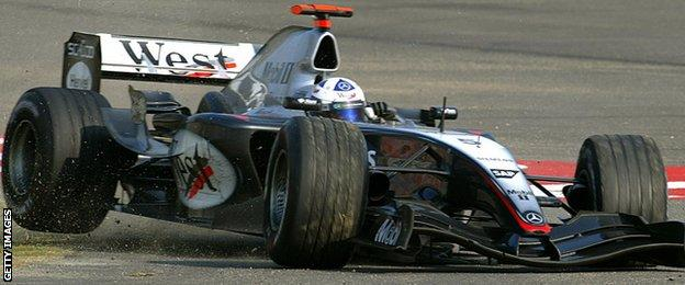 McLaren's David Coulthard spins off a track as the front left tyre is punctured during the Chinese Grand Prix in Shanghai, 26 September 2004