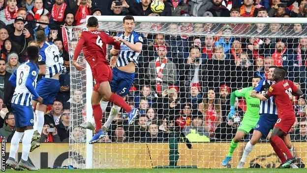 Liverpool 2 1 Brighton Hove Albion Leaders Move 11 Points Clear Despite Alisson Red Card Bbc Sport