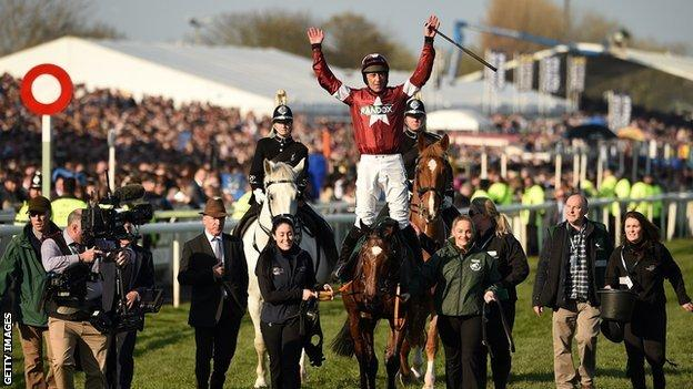 Davy Russell celebrates on Tiger Roll in 2019