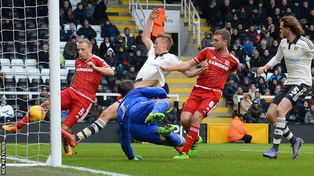 Middlesbrough's Ritchie De Laet's clears Michael Madl's header off the line during the game against Fulham