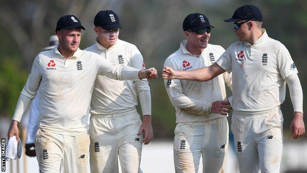 England players (from left to right) Matt Parkinson, Ollie Pope, Dom Bess and Sam Curran congratulate each other as they walk off after day two of a warm-up match in Sri Lanka