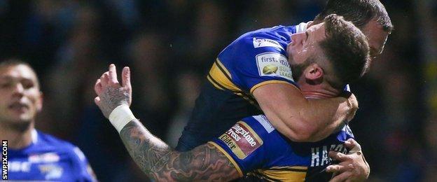 Zak Hardaker celebrates Leeds' first try