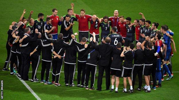 The Welsh team gather after the final whistle for one last huddle