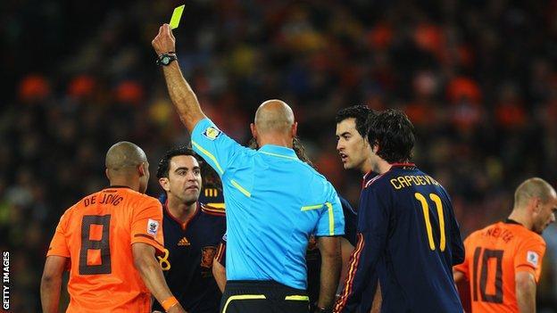 Howard Webb books Nigel de Jong in the World Cup final between Netherlands and Spain in 2010