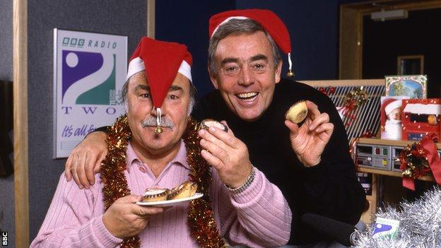 Jimmy Greaves (left) and St John in Christmas hats