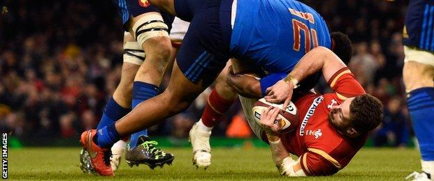 Alex Cuthbert of Wales is tip tackled by Jonathan Danty