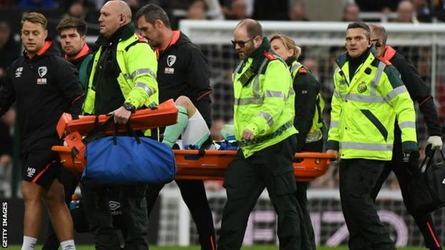Adam Smith is taken off on a stretcher
