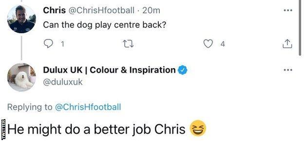 """A since deleted tweet sent by the official Dulux account saying """"He might do a better job Chris"""" in reply to a user asking if their dog mascot can play at centre-back"""