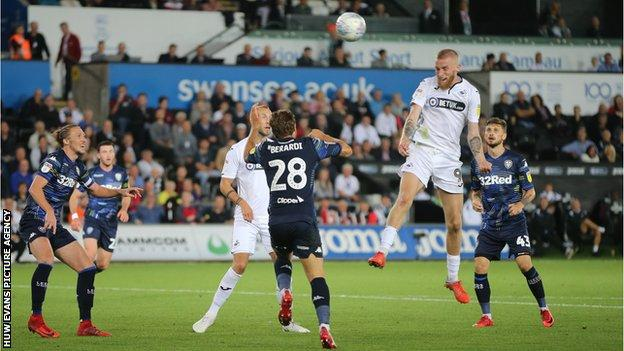 Oli McBurnie's header had put Swansea 2-1 ahead before Pablo Hernandez rescued a point for Leeds