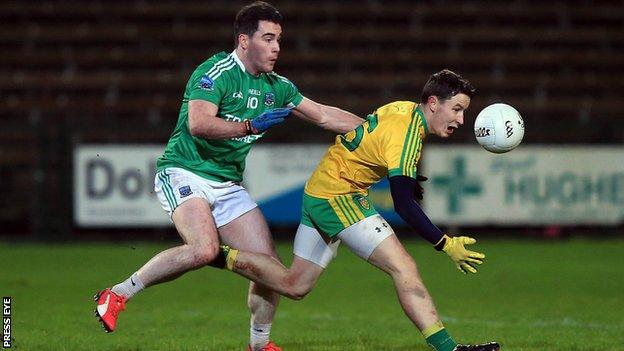Fermanagh's Barry Mulrone challenges Donegal's Eoin McHugh