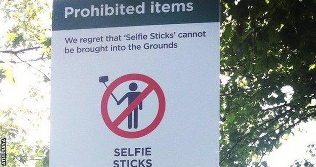 A sign shows selfie sticks are banned