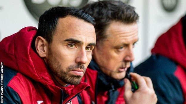 In his final season Leon Britton took a coaching role at the club for a month under former manager Paul Clement
