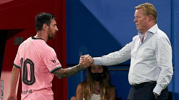 Lionel Messi shakes hands with Ronald Koeman