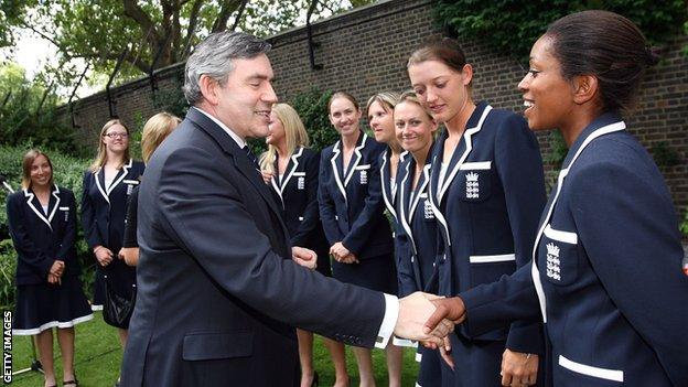 Ebony Rainford-Brent shakes hands with former UK Prime Minister Gordon Brown in 2009