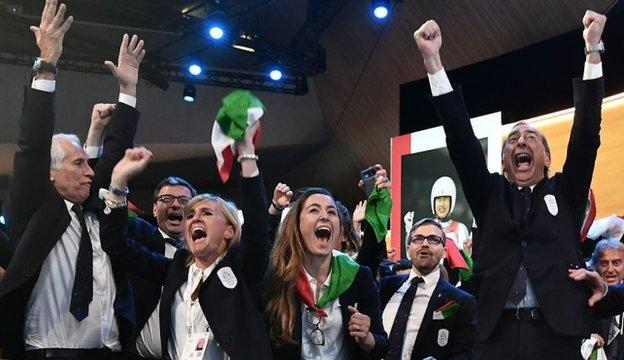 Members of the Italian delegation celebrate Milan-Cortina being named as hosts for the 2026 Games