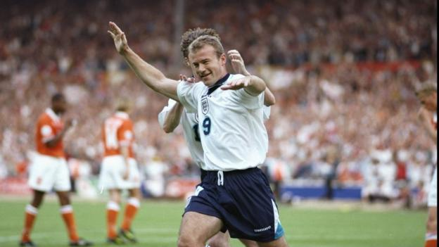 Alan Shearer celebrates scoring for England