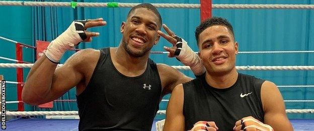 Anthony Joshua and Delicious Orie
