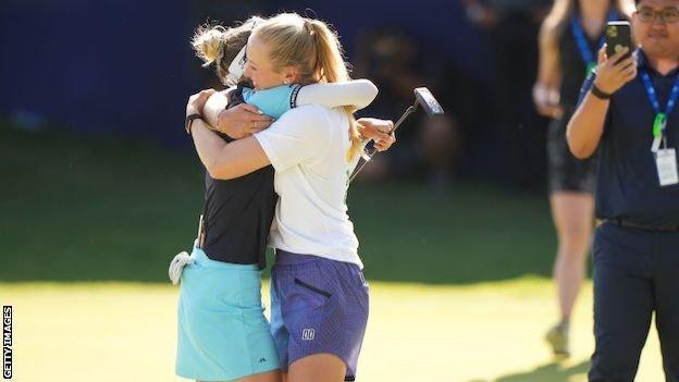 Nelly and Jessica Korda hug