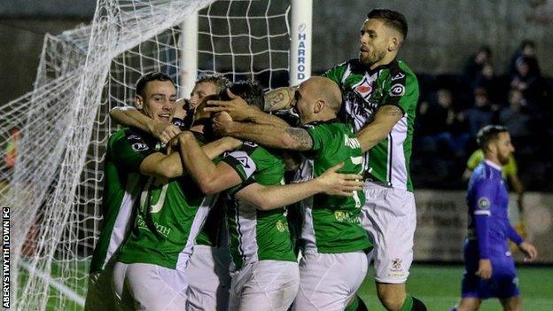 Aberystwyth players celebrate Lee Jenkins' winning goal against New Saints