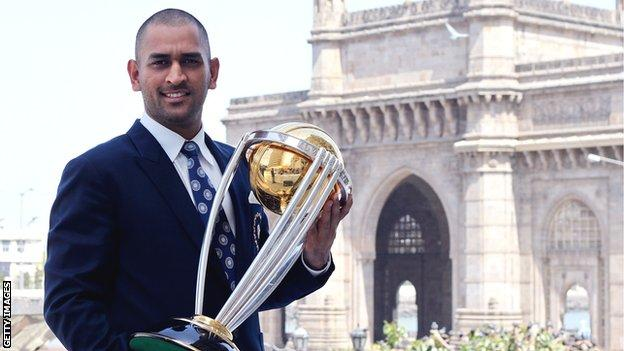 MS Dhoni poses with the 2011 World Cup trophy