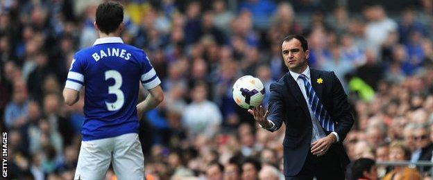 Everton manager Roberto Martinez and full-back Leighton Baines