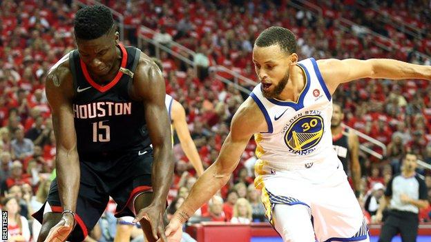 Houston Rockets' Clint Capela (left) and Golden State's Stephen Curry