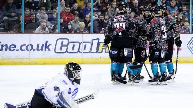 Lightning netminder Adam Goss can only look on as the Giants celebrate after a Blair Riley goal