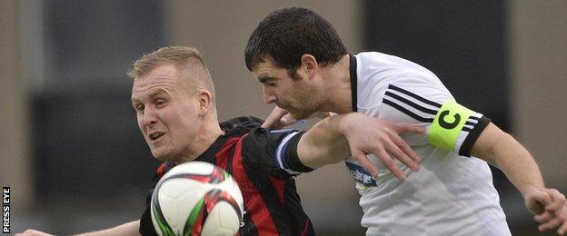 Crusaders striker Jordan Owens in action against Rathfriland's Conor Larkin