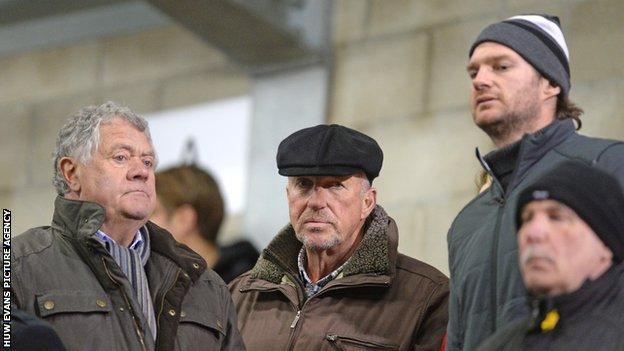 Liam Botham (right) and Lord Botham (centre) and Max Boyce (left) watching James play for Wales Under-18s against Italy in 2016