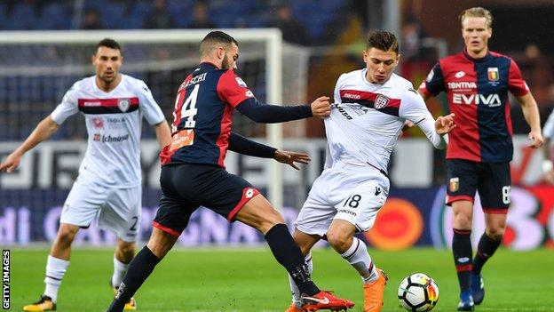 Nicolo Barella of Cagliari tries to get past Davide Biraschi of Genoa