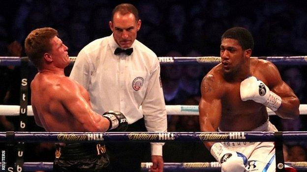 Anthony Joshua beat Alexander Povetkin to retain world heavyweight titles at Wembley Stadium