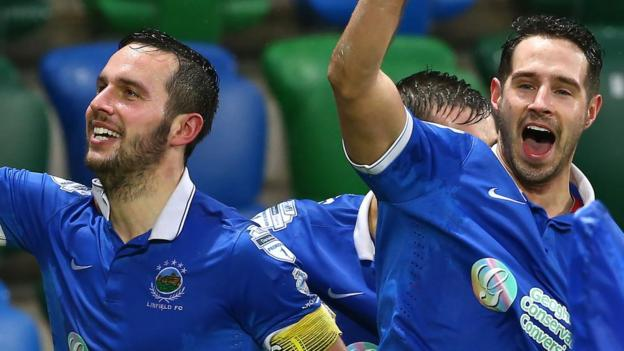 Andrew Waterworth and Sean Ward celebrate after striker Waterworth had scored Linfield's first in their 2-0 win over Premiership leaders Crusaders