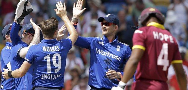 Chris Woakes and Alex Hales (right) combined to dismiss Kraigg Brathwaite