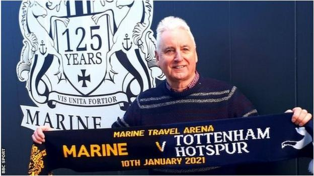 Marine chairman Paul Leary with a half and half scarf to commemorate Marine's FA Cup third round tie with Tottenham Hotspur