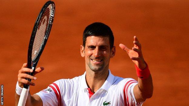 Novak Djokovic celebrates beating Pablo Cuevas at the French Open