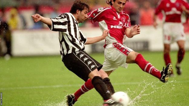 Juventus' Alessandro del Piero tries to play the ball off Giovanni Tedesco
