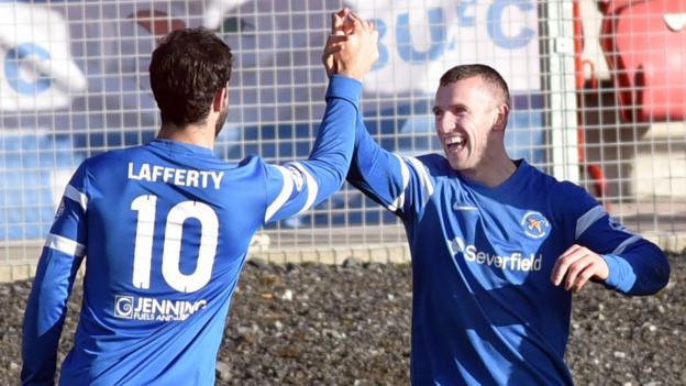 Johnny Lafferty congratulates Ryan Campbell who scored the second of Ballinamallard's three goals against Portadown at Shamrock Park