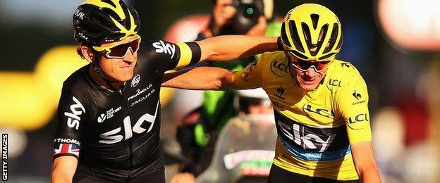 Geraint Thomas crosses the Tour de France finish line with winner and Team Sky leader Chris Froome
