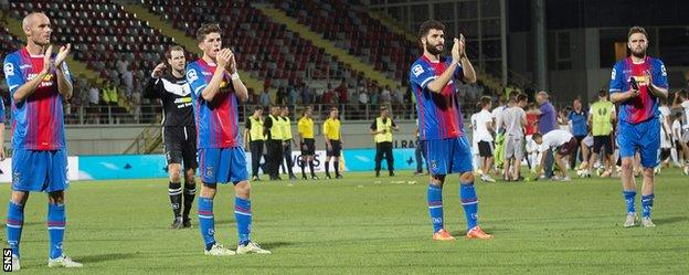 Caley Thistle players applaud their fans