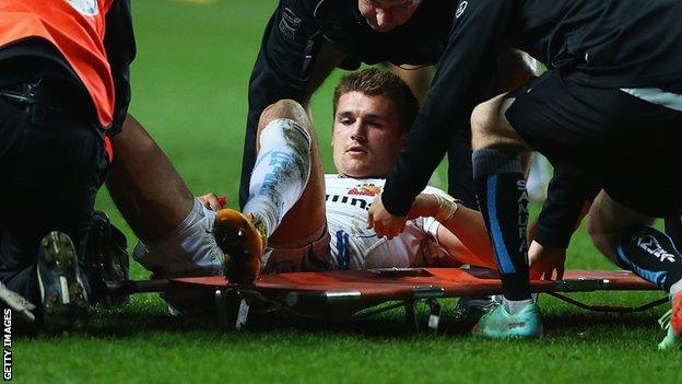 Henry Slade is stretchered off