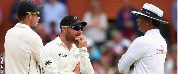 New Zealand captain Brendon McCullum talks to umpire