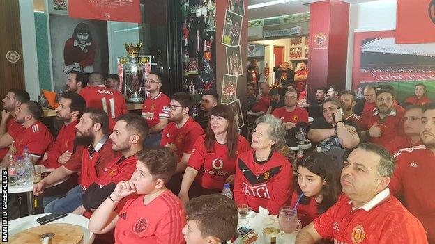Members of the Manchester United Greek Supporters' Club gather in Athens to watch a game