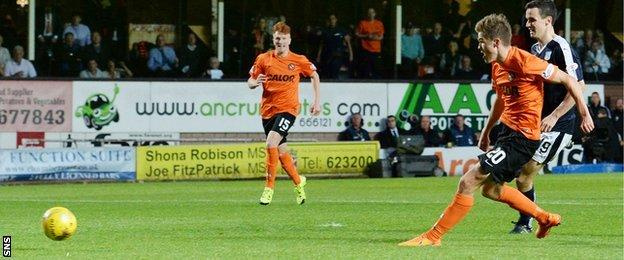 Blair Spittal slots home his second goal for Dundee United against Dundee