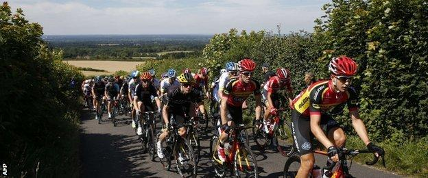 The riders make their way up Staple Lane in Surrey
